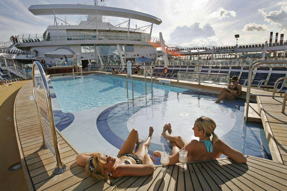 One of the pools on board the world's largest and newest cruise ship, Oasis of the Seas, is seen at Port Everglades in Ft. Lauderdale, Fla. Friday, Nov. 20, 2009. The Finnish built 225,282-ton ship owned by Royal Caribbean International has a capacity of 5,400 passengers and is set for its debut voyage in the Caribbean Dec. 1, 2009. 15 decks house 4 main swimming pools, a park promenade, surf simulators, rock climbing, and miniature golf. (AP Photo/ Hans Deryk)